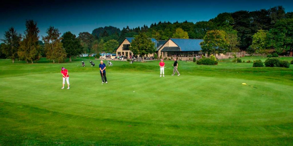 Woll Golf Course Club House and golfers on course